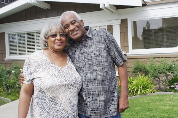 Retired couple smiling in yard